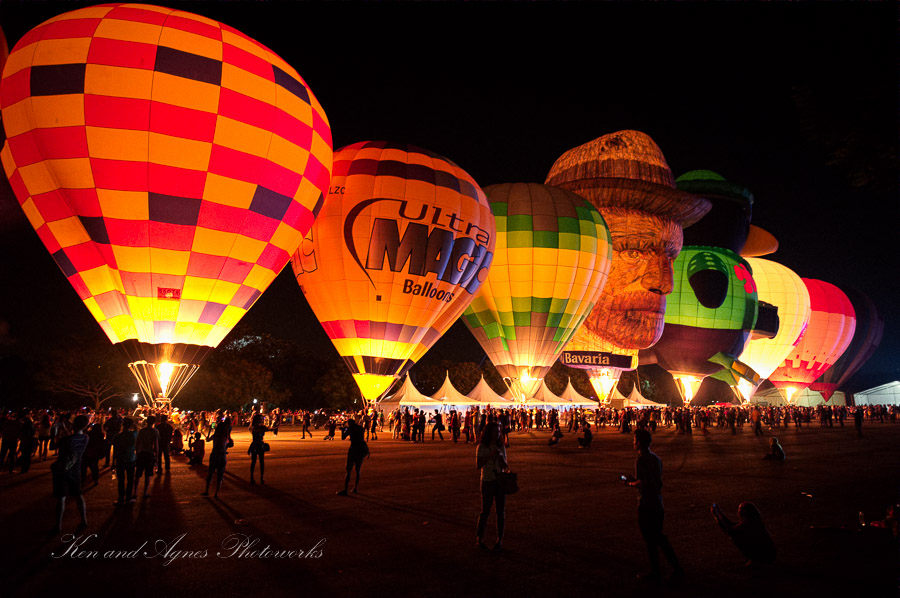 Balloons light up the night sky